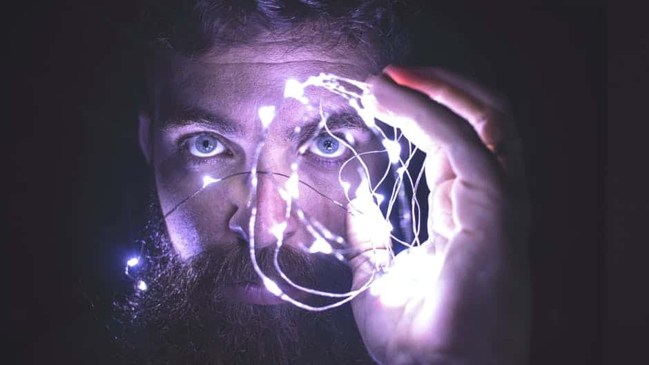 Communicating with the Subconscious Mind - A close up of a man making a face for the camera - Light