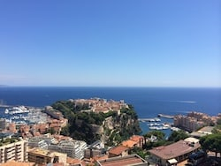 Hypnosis in Monte-Carlo - A view of a city next to a body of water - Promontory